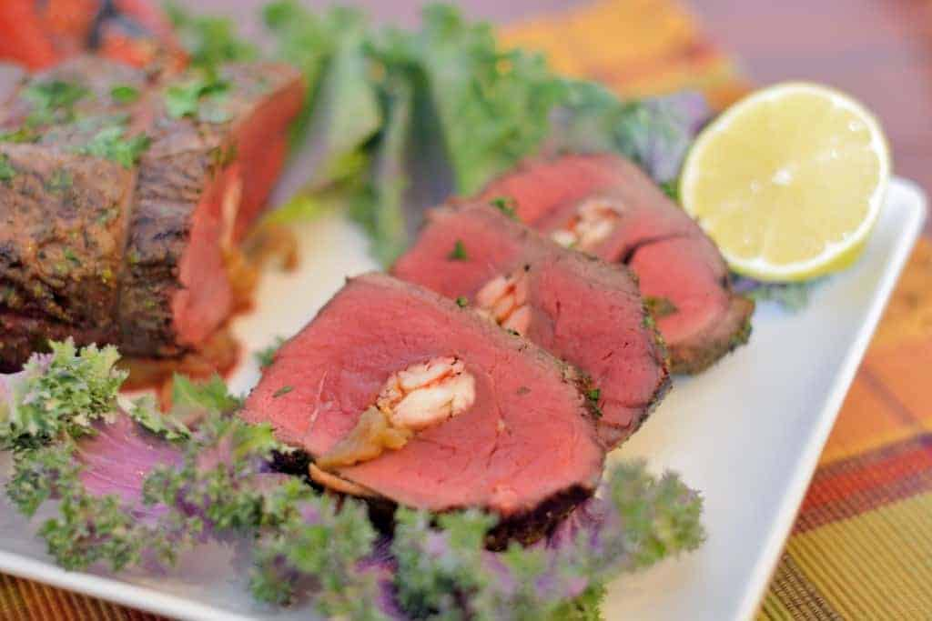 Crab Stuffed Beef Tenderloin- worthy of a special occasion and easy to make, pin NOW for Valentine's Day! #beeftenderloin www.savoryexperiments.com