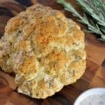 Roasted Cauliflower Recipe- yogurt and herb crusted cauliflower, the perfect accompaniment for any meal. #cauliflower www.savoryexperiments.com