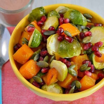 Brussels Sprout Salad Recipe is colorful and the perfect blend of sweet, salty, and savory. This dish is sure to have your guests going back for seconds. #brusselssprouts #sidedish #sweetandsavory www.savoryexperiments.com