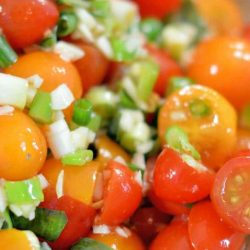 Winter Tomato Salad uses multi-colored cherry tomatoes, lots of garlic, good olive oil and basil to make a tasty side dish recipe perfect for the winter months. #tomatosalad #tomatosidedishes www.savoryexperiments.com