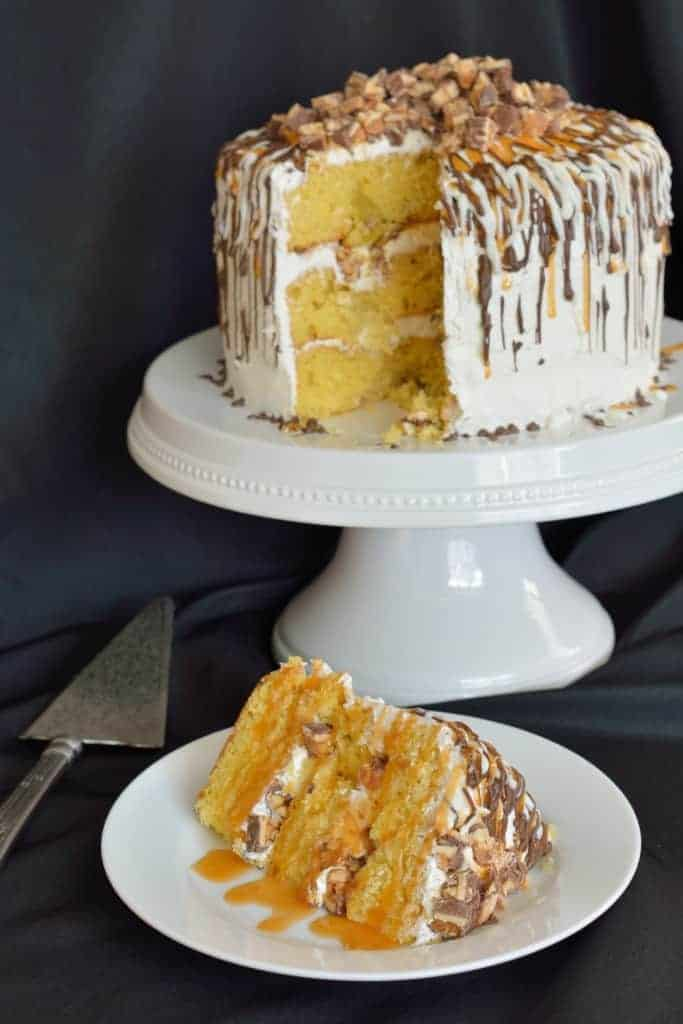 layers of yellow cake with baked green apples, white frosting, chopped ...