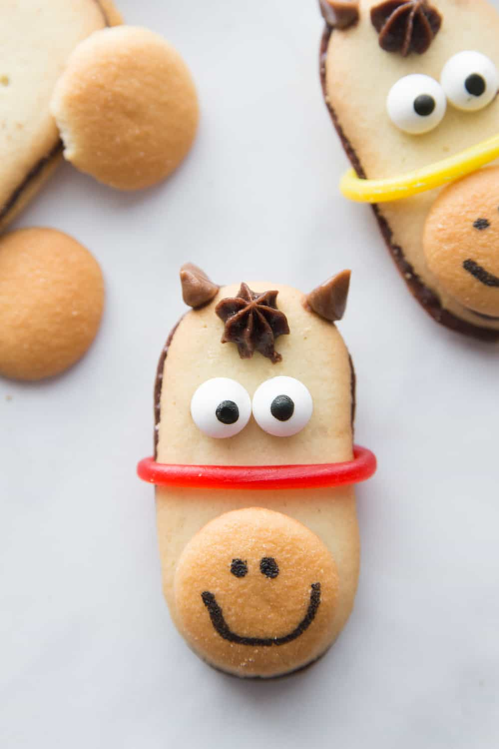 No Bake Horse Cookies are perfect for a Kentucky derby party, triple crown races, or horse themed parties! These horse cookies are the best no bake cookies! #horsecookies #nobakecookies #kentuckyderbyparty www.savoryexperiments.com
