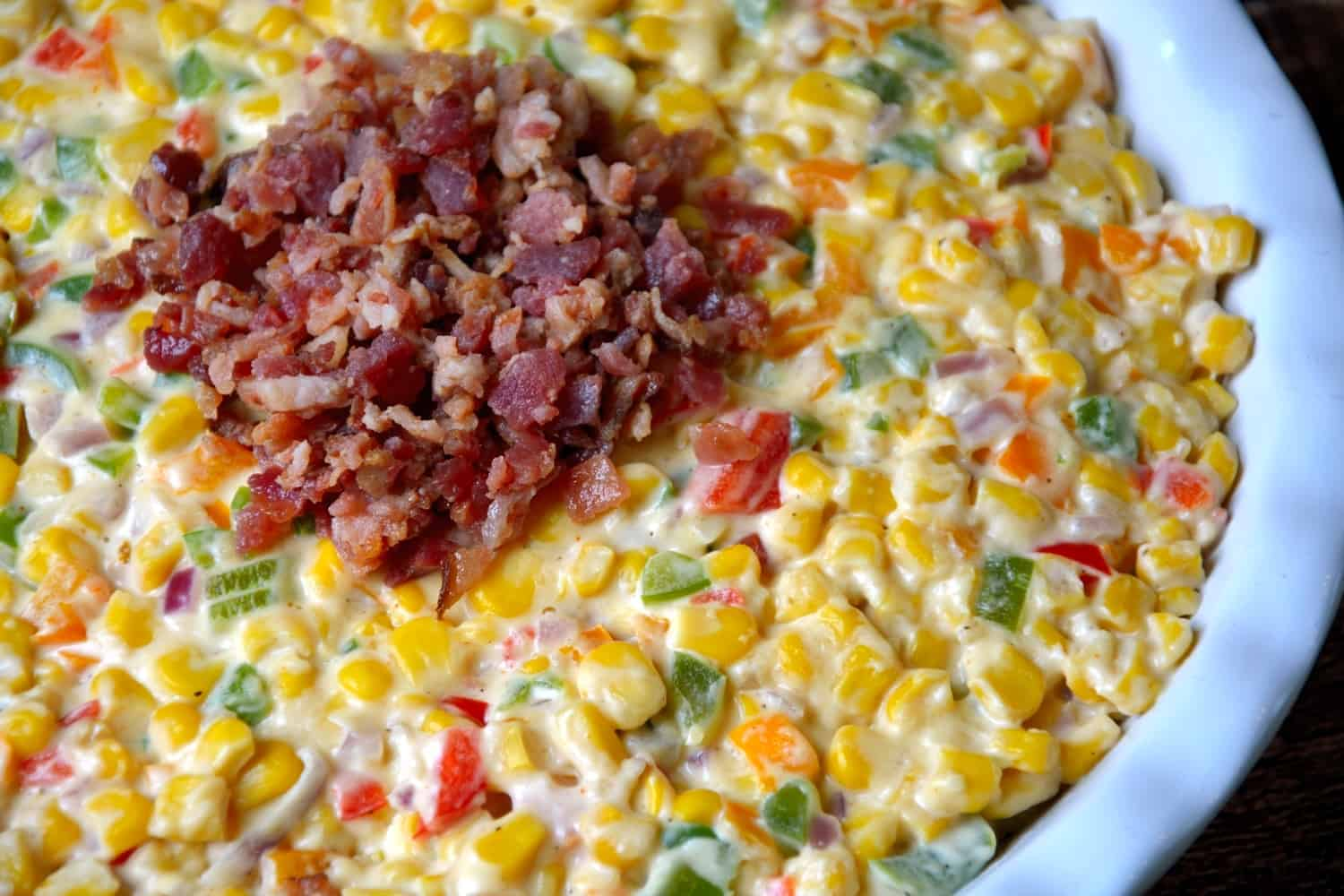 Creamy Corn and Bacon Dip is a blend of fresh vegetables, bacon and decedent cream cheese for an appetizer that complements any occasion. | www.savoryexperiments.com