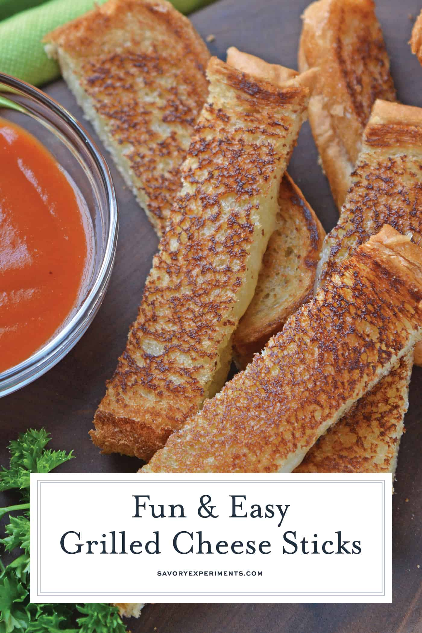 Grilled Cheese Sticks make your childhood favorite into a party-worthy appetizer! Pair with tomato soup or tomato jam for an upscale grilled cheese sandwich recipe.#grilledcheeserecipe www.savoryexperiments.com