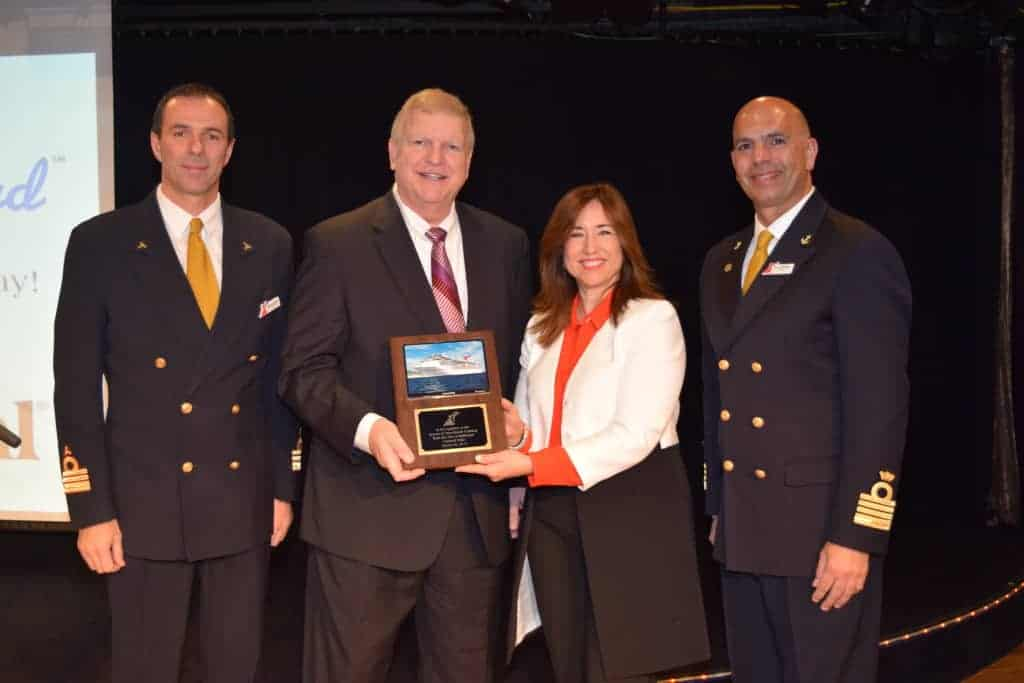 (From left) Carnival Pride Chief Engineer Aniello Esposito, Maryland Transportation Secretary Pete Rahn, Carnival President Christine Duffy and Carnival Pride Captain Francesco Borgogna pose with a plaque presented to Rah during a reception on board the Carnival Pride commemorating the ship's resumption of year-round service from the Port of Baltimore. Carnival Pride, which features a number of new innovations added during a multi-million-dollar dry dock, offers five- to 14-day cruises from Baltimore.