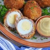 Scotch Eggs on a platter, one cut in half