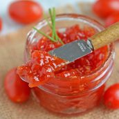 Tangy and sweet, tomato jam is excellent on everything from grilled cheese to deviled eggs, hamburgers and charcuterie boards. #tomatojam #homemadejamrecipe www.savoryexperiments.com