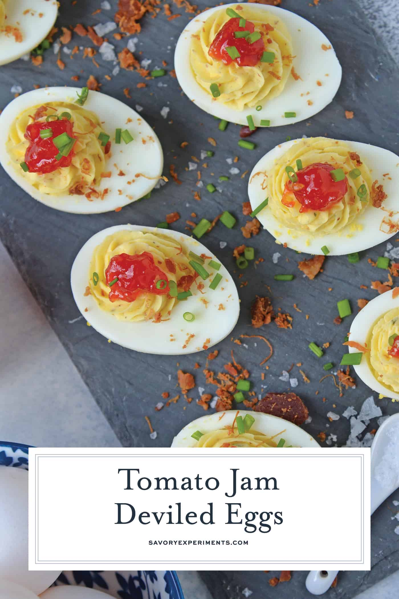 Tomato Jam Deviled Eggs use sweet tomato jam with tangy horseradish in a devilishly creamy deviled egg filling. Top with chives and serve! #deviledeggs www.savoryexperiments.com