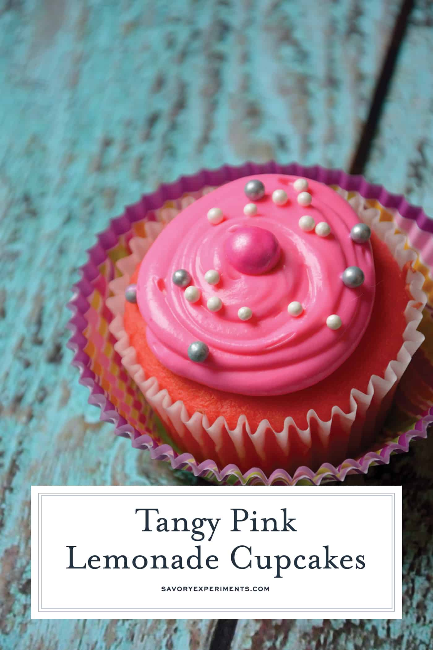 Pink Lemonade Cupcakes are an easy cupcake recipe using boxed cake mix with lemon flavoring and pretty pink food coloring. Perfect for any spring event! #easycupcakerecipe #pinklemonadecupcakes www.savoryexperiments.com