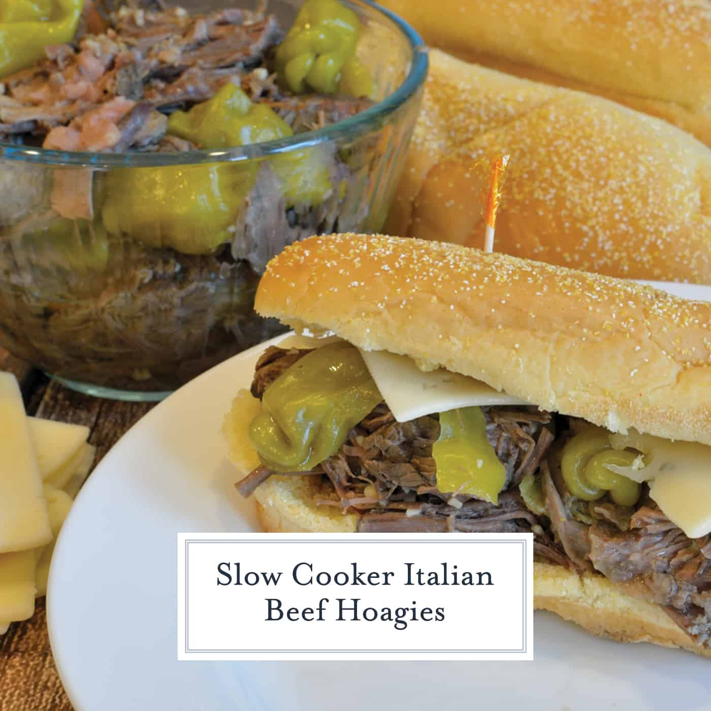 Slow Cooker Italian Beef Hoagies is pot roast cooked in pepperoncini chiles until fork tender, then smothered in cheese and serve on a hoagie roll. Great for parties too! #italianbeefhoagies #mississippipotroast www.savoryexperiments.com