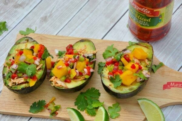 Grilled Avocados with Peruvian Chicken and Mango Salsa- spiced chilled chicken and sweet mango salad over creamy, hot avocados. Can you believe it only takes 15 minutes to prepare?? | #grilledavocados | www.savoryexperiments.com