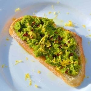 Serve Lemony Pea Mash Crostinis with at room temperature with a chilled, crisp white wine for a vibrant and colorful appetizer. | #peacrostinis | www.savoryexperiments.com