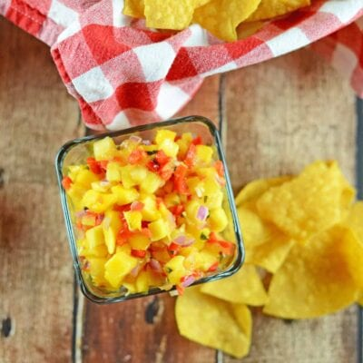 Fresh Mango Salsa is a fruity salsa recipe perfect for serving with tortilla chips or even on top of grilled chicken, steak or seafood. Perfect for BBQs and potlucks. #mangosalsa #fruitsalsarecipes www.savoryexperiments.com