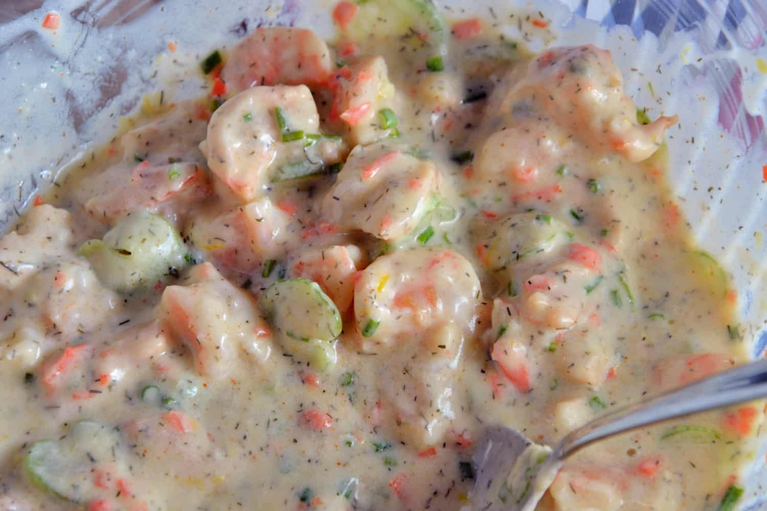 Lemon Garlic Shrimp Salad is a healthier version of classic comfort food using plain yogurt, celery, carrots, chives, dill and spices on a buttery brioche roll. www.savoryexperiments.com