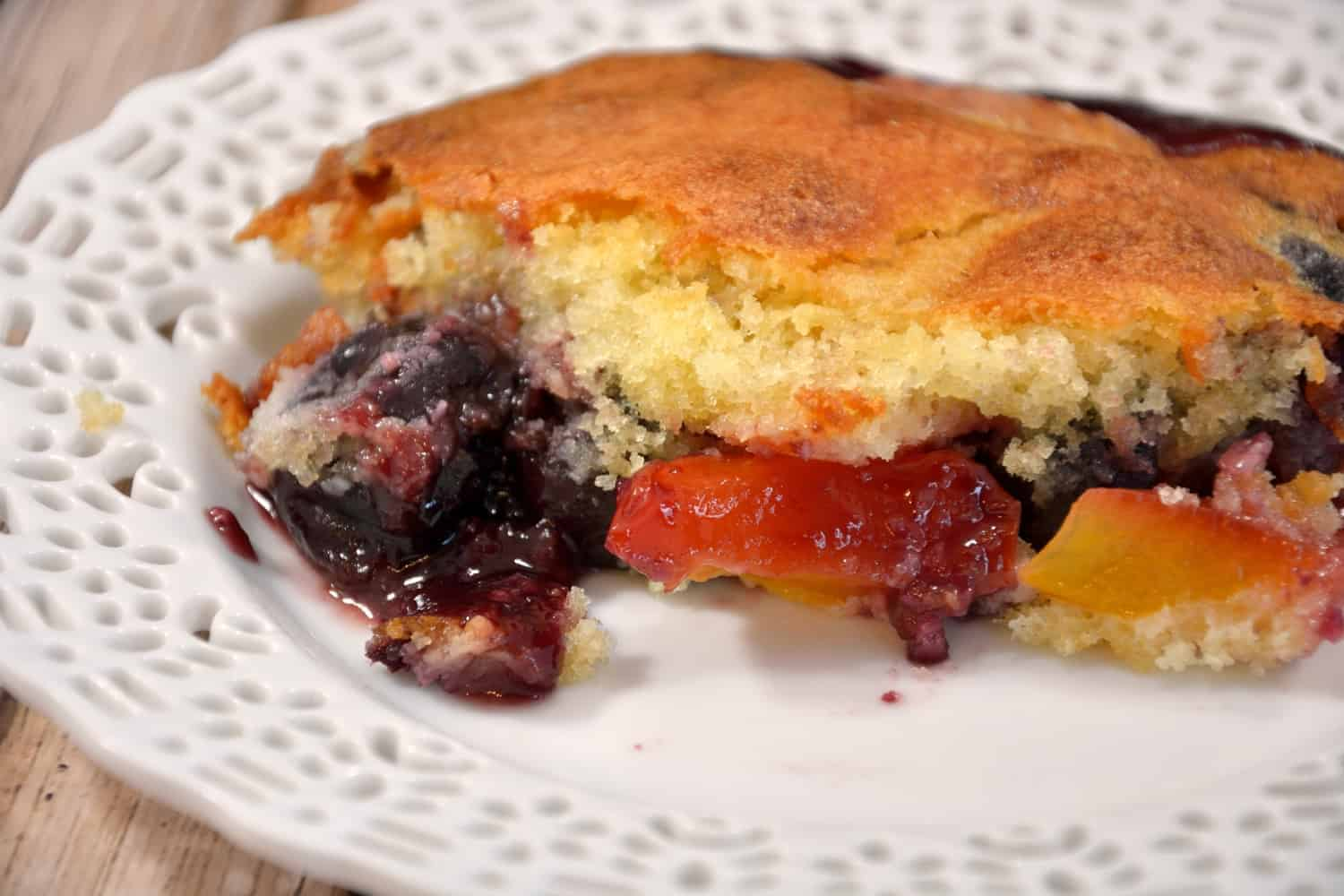 Peach and Cherry Cobbler Recipe is an essential summer dessert with lush stone fruits and an almond essence breading. | #cobbler | www.savoryexperiments.com