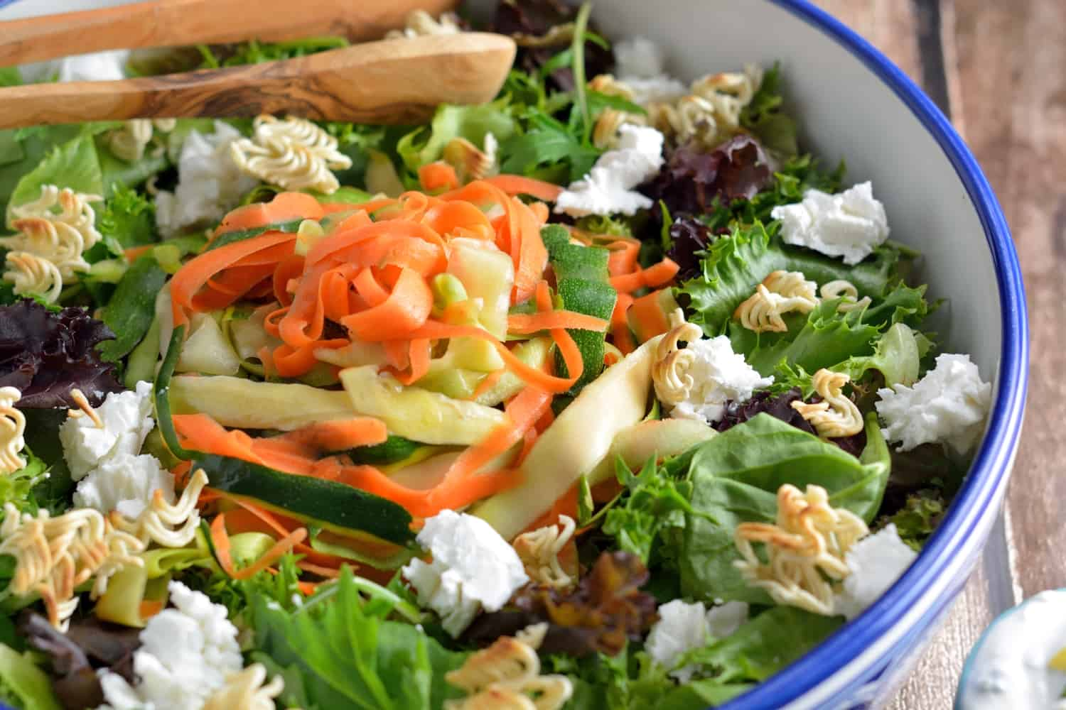 Shaved Zucchini Salad with Lemon-Chive Dressing - spring greens, soft goat cheese, toasted ramen croutons, marinated zucchini, squash and carrots with a yogurt-based lemon chive dressing. www.savoryexperiments.com