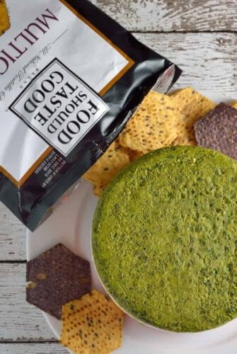 Layered Two Pesto and Ricotta Dip recipe features three distinct layers of red and green pesto with blended cheeses paired with Food Should Taste Good™ chips. | #foodshouldtastegood #sp | www.savoryexperiments.com