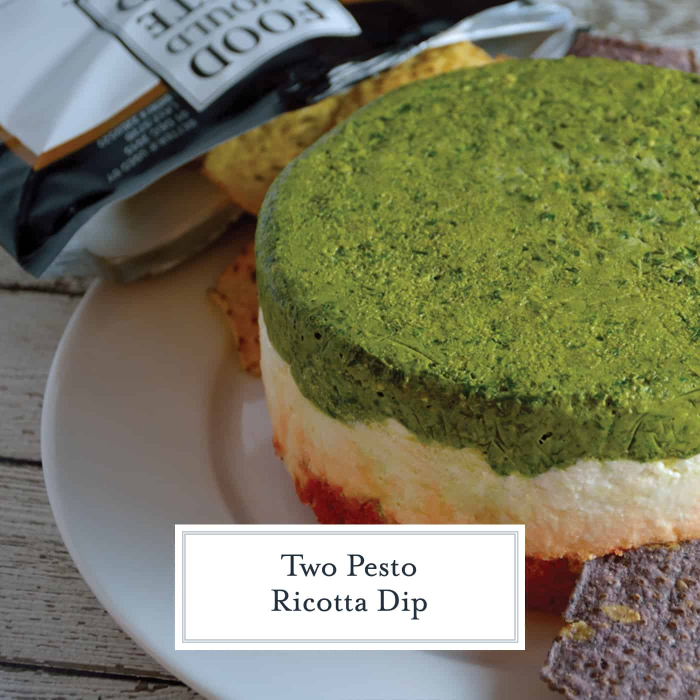 Two Pesto Ricotta Dip combines layers of traditional basil pesto, roasted red pepper and sun dried tomato pesto with ricotta, goat and Parmesan cheese. Chilled in a mold, it is a beautiful red, green and white! #pestodip #ricottadip www.savoryexperiments.com