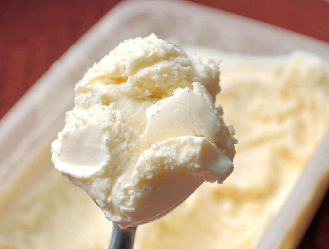 Classic Vanilla Bean Ice Cream Recipe- store bought ice cream uses spent vanilla beans. Get all the flavor by making your own with fresh pods and only 4 other ingredients! | #vanillaicecream | www.savoryexperiments.com