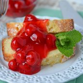 Slice of almond pound cake topped with cherries