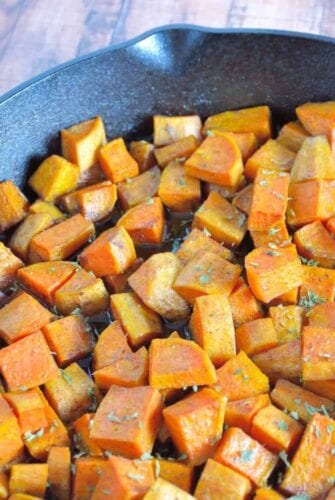Cast Iron Sweet Potatoes with Honey and Cinnamon Recipe- peeled sweet potatoes tossed in sticky honey and sweet cinnamon, baked with a golden crust in cast iron.
