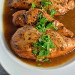 Slow Cooker Apple Balsamic Chicken in a white dish