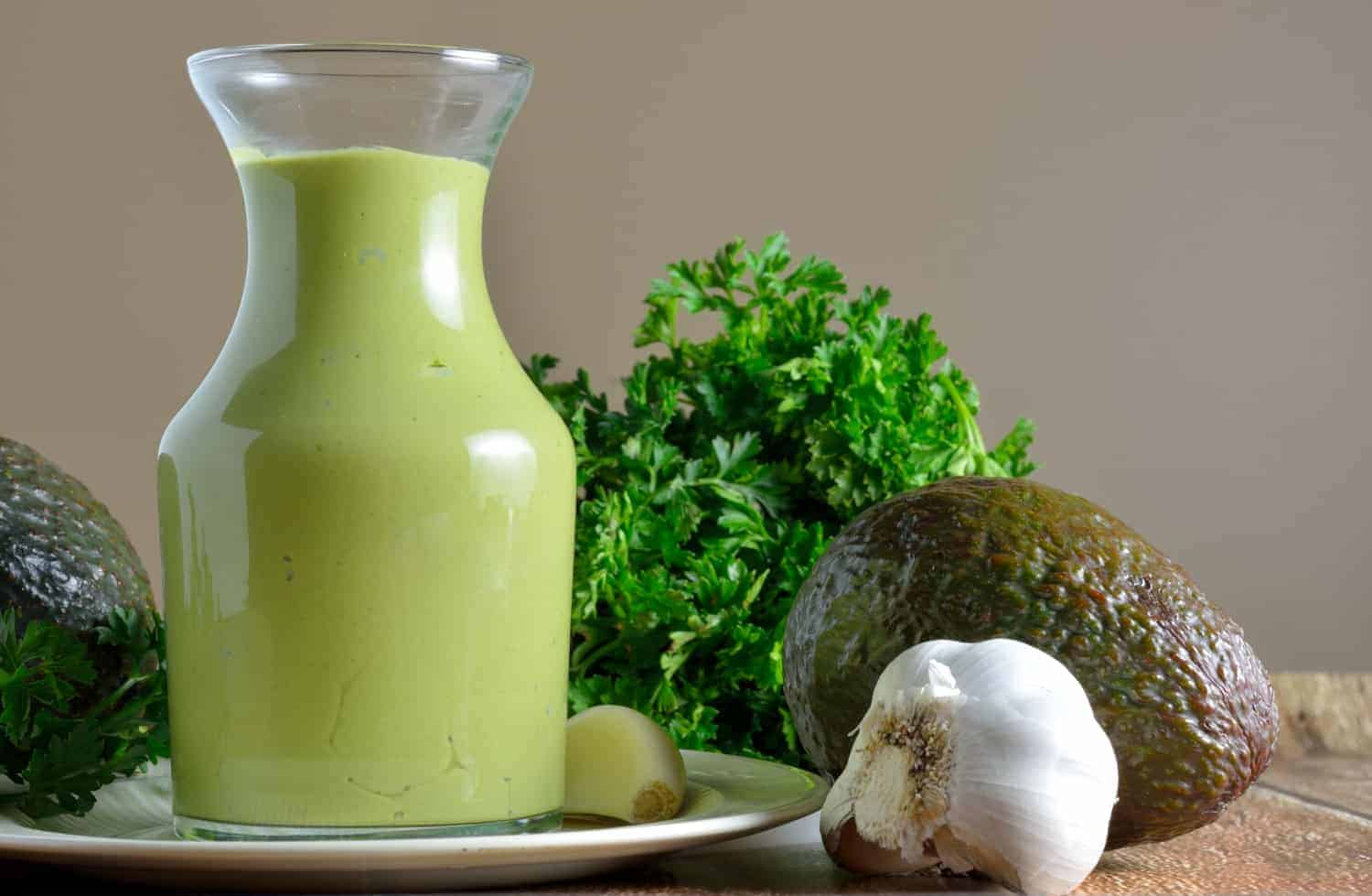 Avocado Green Goddess Dressing Recipe- A tangy and creamy condiment packed with nutrient dense ingredients like avocado, garlic, parsley and yogurt. Serve as a dipping sauce, spread on sandwiches or salad dressing.