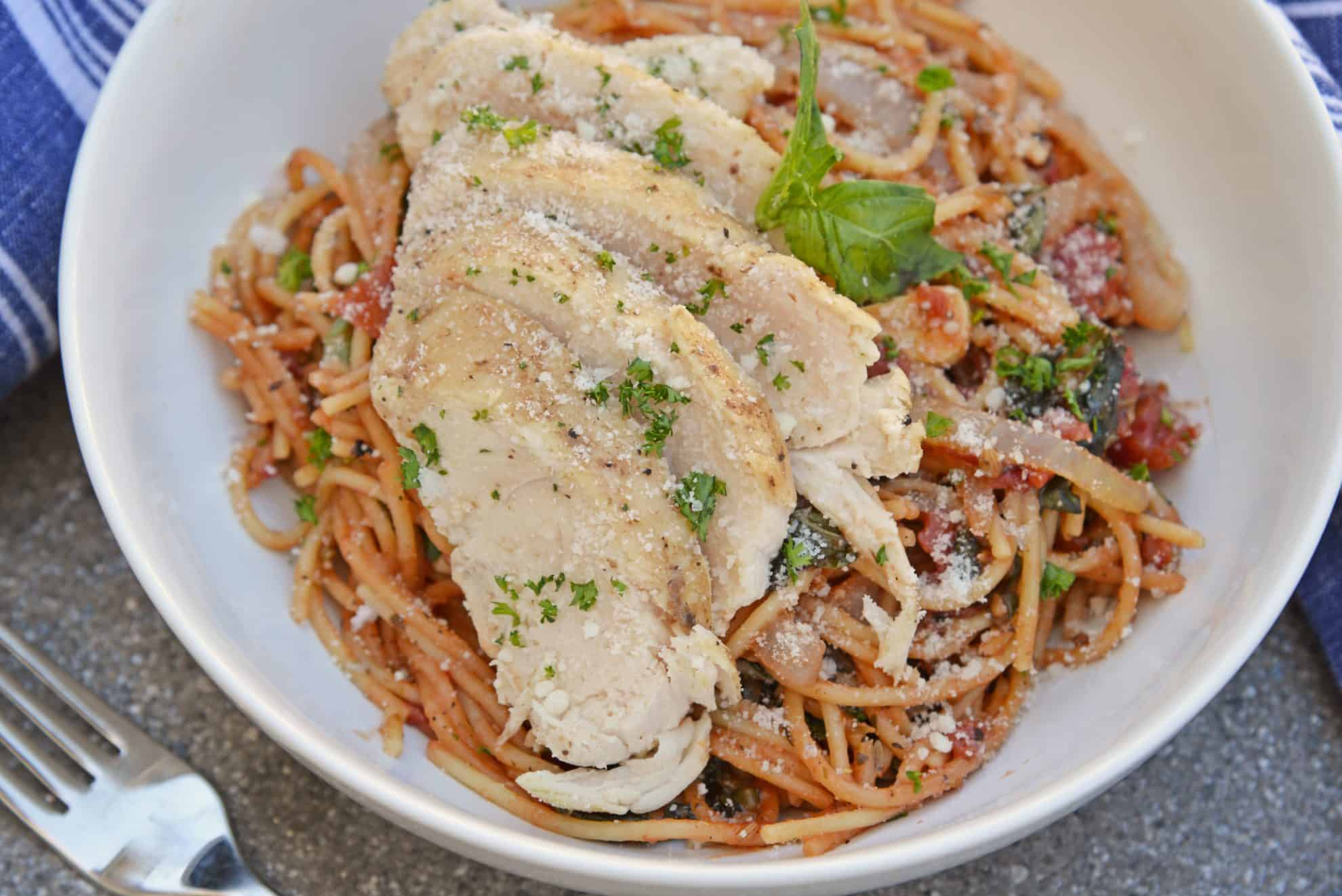 Tomato Basil Chicken Pasta in a white bowl