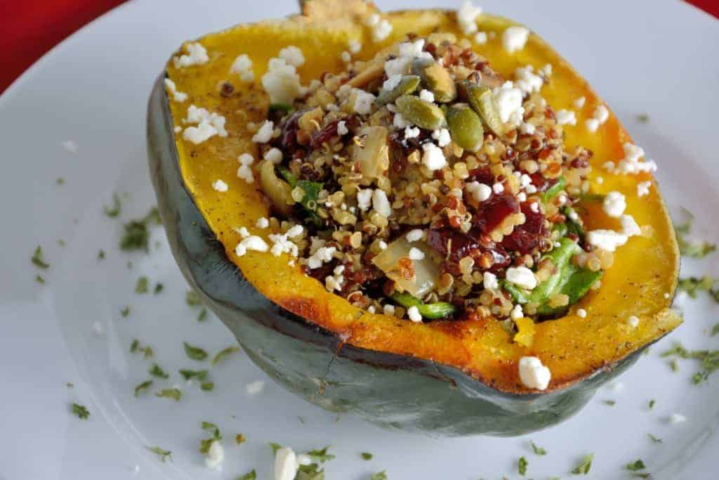 Quinoa Stuffed Acorn Squash Recipe- Tender acorn squash stuffed with ...