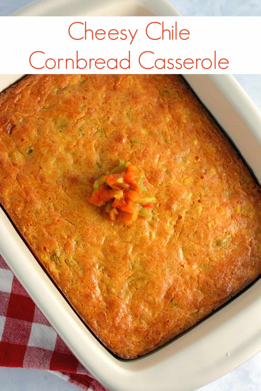 Cheesy Chile Cornbread Casserole Recipe- moist cornbread with chiles, corn and a cheese blend. Add shredded chicken or beef for a whole meal!