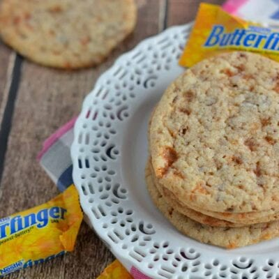 These soft, Chewy Butterfinger Sugar Cookies are a great way to incorporate a delicious classic, BUTTERFINGER® into your baking.  #butterfinger #sugarcookies www.savoryexperiments.com