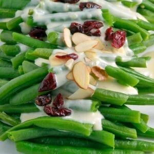 Green Beans in Mascarpone Cream Sauce is a sophisticated and delicious update to the old green bean casserole. It is sure to become a family favorite. #greenbeans #mascarponecreamsauce www.savoryexperiments.com