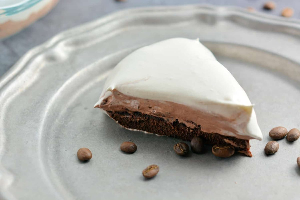 Mocha Cream Pie Recipe is three layers of delicious pie: brownie base, chocolate pudding,and whipped cream top all laced with coffee. #mochacreampie #brownies #creampie www.savoryexperiments.com