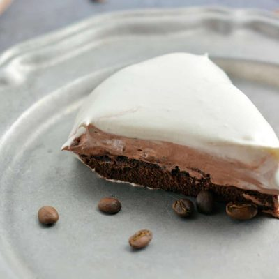 Mocha Cream Pie Recipe is three layers of delicious pie: brownie base, chocolate pudding, and whipped cream top all laced with coffee. #mochacreampie #brownies #creampie www.savoryexperiments.com