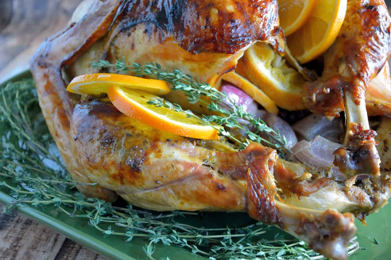 Orange Thyme Turkey is the BEST roasted turkey recipe for juicy turkey and guaranteed to give you the best drippings to make a flavorful gravy.  #roastturkey #thanksgiving www.savoryexperiments.com