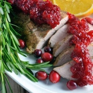 pork tenderloin sliced with cranberry sauce