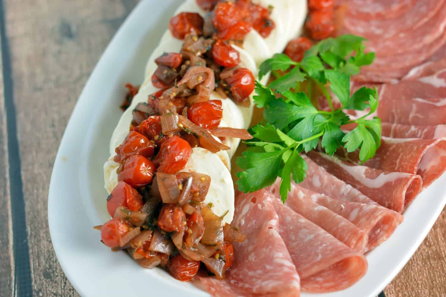 Warm Tomato and Shallot Mozzarella Cheese Recipe- Grape tomatoes and shallots simmered in a sweet balsamic sauce over soft mozzarella cheese. It only takes 6 ingredients and 20 minutes!