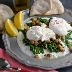 Za'atar Chickpeas and Poached Eggs is a refreshing, health and gluten-free breakfast option. Lemon zested yogurt sauce, za'atar spiced chickpeas, wilted spinach and poached eggs sprinkled with pink sea salt.