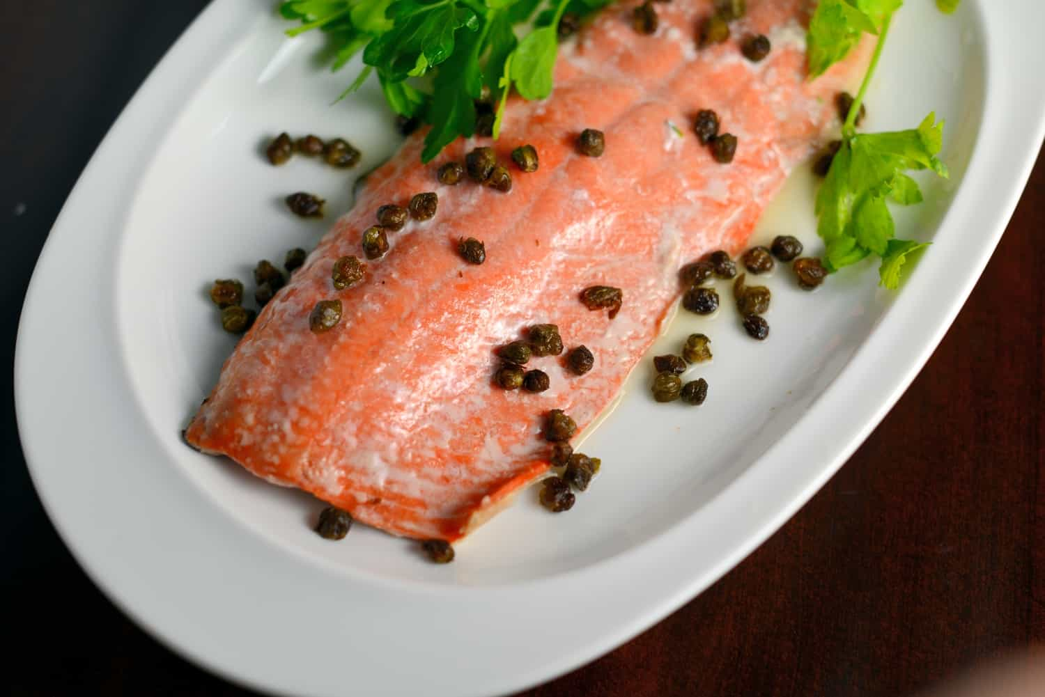 Crispy Caper Lemon Salmon is one of the best healthy salmon recipes. This lemon salmon is quick, easy and healthy! Crispy capers add texture sophistication to this easy weeknight meal.