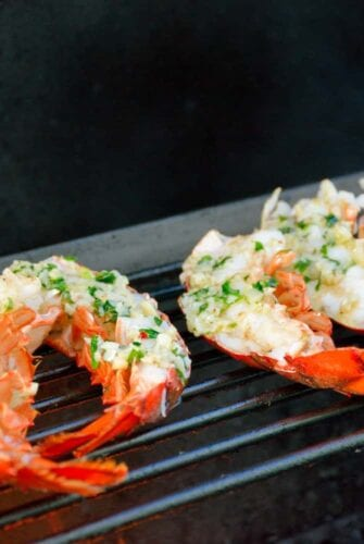 Grilled Lobster Tails Recipe- Succulent, tender lobster tails grilled to perfection with garlic, butter and parsley.