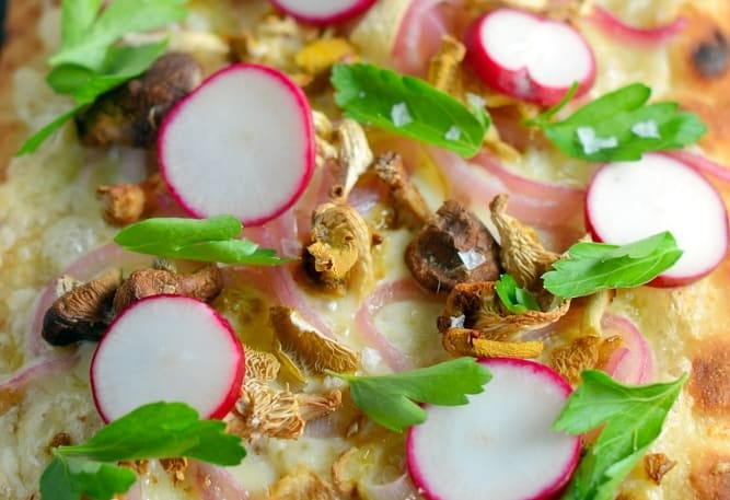 Horseradish and Mushroom Flatbread can be served as an appetizer or entree, perfect for your vegetarian friends, but hearty enough for meat-eaters. A mushroom blend, fresh radishes, pickled red onion, tangy horseradish cheddar cheese, Italian parsley and Maldon sea salt make this one of the best dishes you will ever eat!