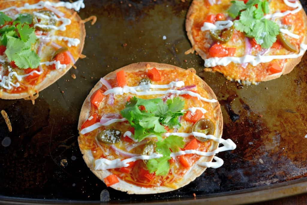Homemade Mexican Pizza is one of our favorite game day recipes! Set up a pizza bar and allow guests to create their own! Cheese, bright veggies and zesty flavors, you can't go wrong