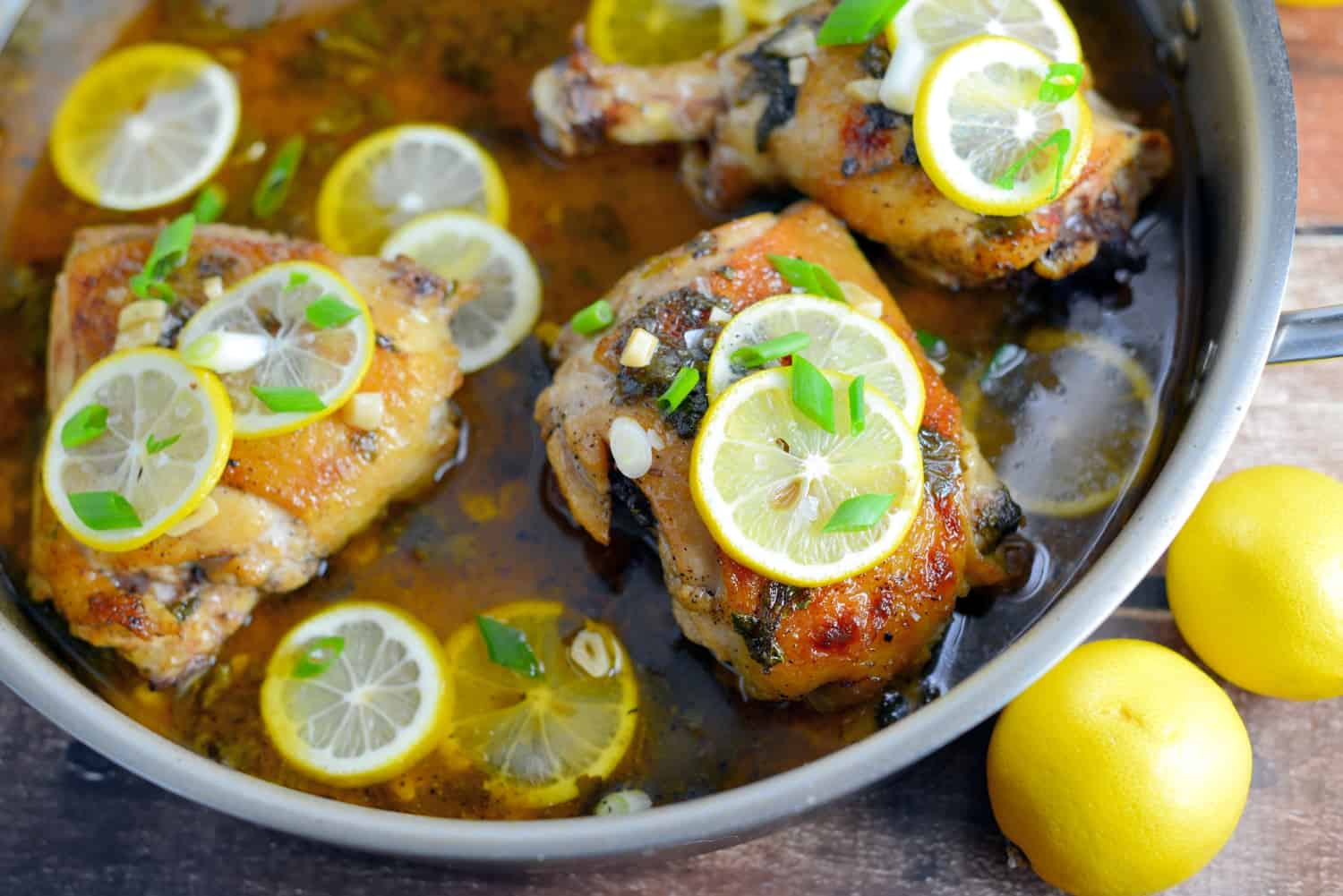 Lemon Garlic Chicken Recipe: This is one-pan dish is the best lemon chicken recipe out there! Use chicken breast, thighs or drumsticks. Tender and flavorful, serve this easy recipe over toasted couscous. www.savoryexperiments.com