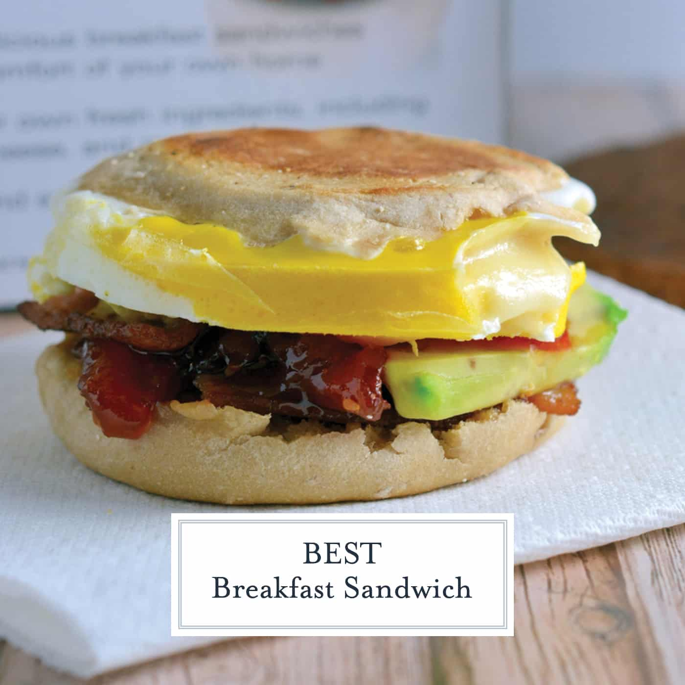 What makes this the BEST Breakfast Sandwich? Egg, provolone, bacon, avocado and one secret condiment! Come see to find out! #easybreakfastideas #breakfastsandwich www.savoryexperiments.com