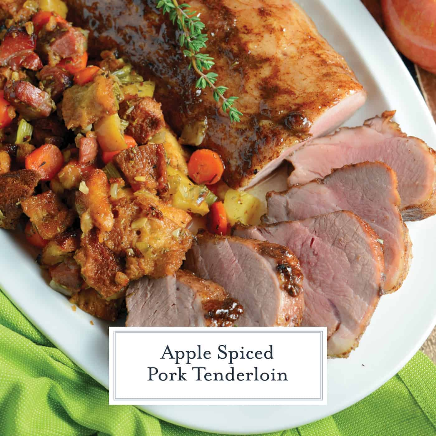 Apple Spiced Pork Tenderloin is a pork tenderloin recipe  that will blow you away with aromatic spices and an apple jelly glaze, surrounding with fresh apple and ham stuffing, all cooked on the same baking sheet. #porktenderloinrecipe www.savoryexperiments.com