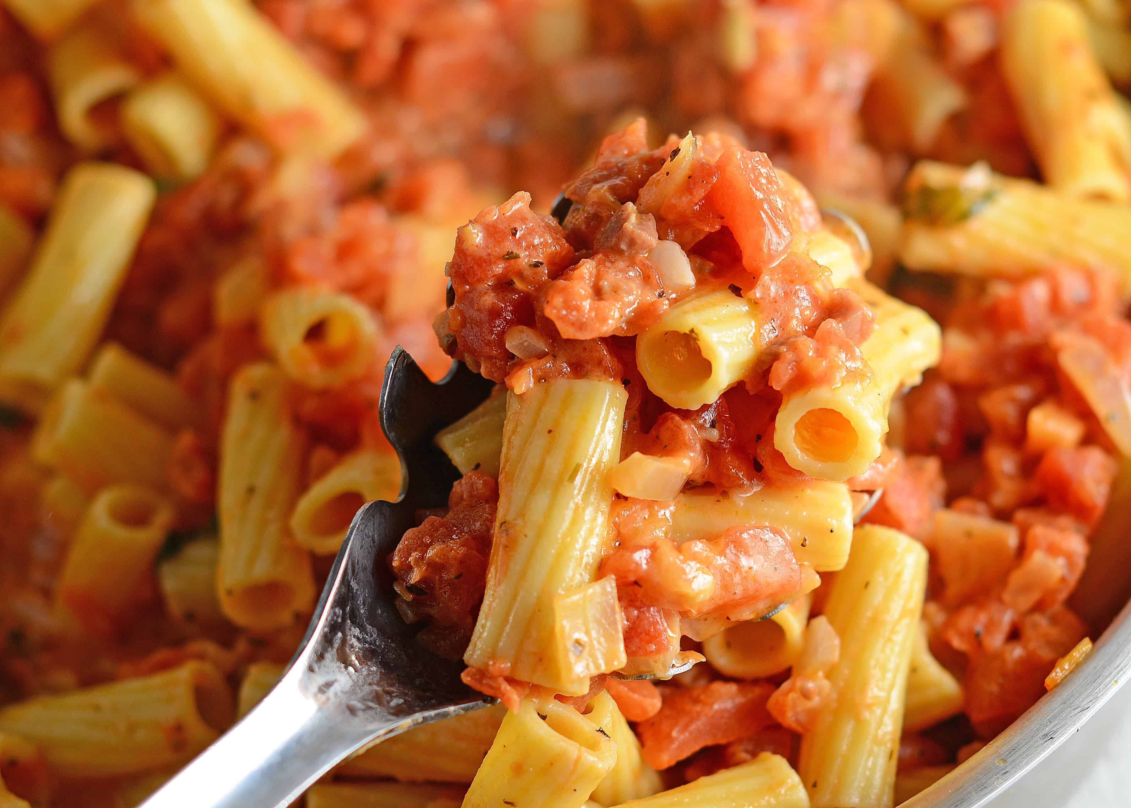 Creamy Vodka Sauce is an easy pasta sauce recipe pancetta, tomatoes and cream. Serve over your favorite pasta like Penne alla Vodka! #vokdasauce #penneallavodka www.savoryexperiments.com