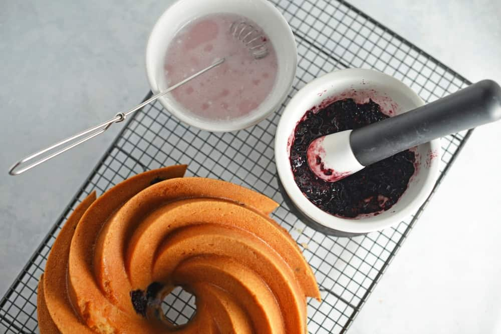 Blackberry Bundt Cake Recipe- my favorite blackberry recipes using fresh blackberries and Blackberry Ginger Ale to make a moist and decadent bundt cake. The consistency of pound cake, it is ideal for brunch, tea or dessert. www.savoryexperiments.com