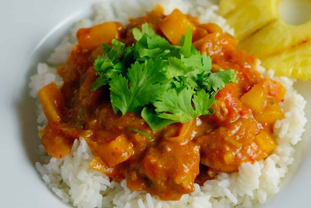 Pineapple and pork curry over white rice