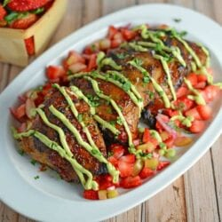 Strawberry BBQ Chicken Recipe- If you like strawberries, you are going to LOVE my strawberry BBQ Sauce recipe. Spread this BBQ sauce over chicken or seafood and serve with Strawberry Salsa on the side. A great and easy grilling idea and perfect for parties and potlucks!