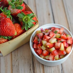 Strawberry Salsa Recipe- only 6 ingredients for this zingy and sweet strawberry salsa! Serve with cinnamon and sugar pita chips, on ice cream, on top of a salad or with grilled salmon, chicken or shrimp.